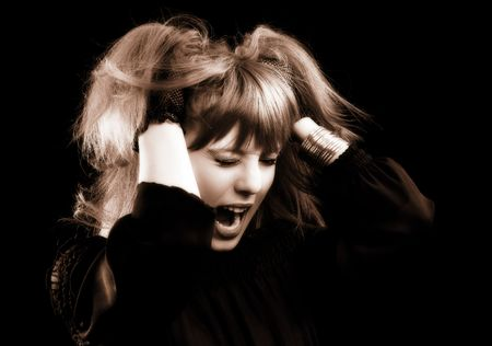 Low key monochrome portrait of a desperate emo girl photo
