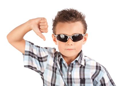 cool down: Cool kid with sunglasses showing thumb down sign Stock Photo