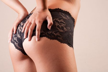 Sexy woman buttocks in black lingerie Stock Photo