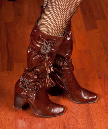 Woman legs in maroon leather boots photo