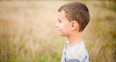 Portrait of a cute kid in profile, over a blurred nature background Stock Photo - 5619595