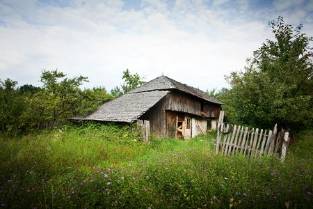 Abandoned house in the countryside near a forest photo