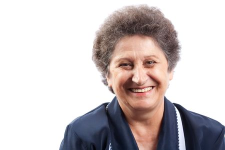 determined: Portret of a happy senior woman laughing Stock Photo