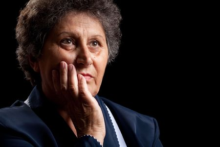 Portrait of a senior woman isolated on black Stock Photo - 5642287
