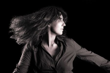 Monochrome toned portrait of a beautiful woman flipping her hair photo