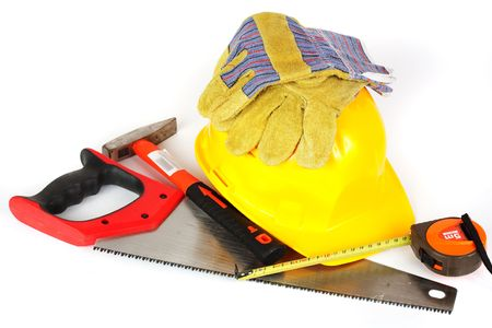 Protection helmet, gloves and construction tools isolated on white background photo