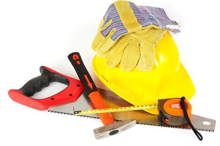 yellow hard hat: Protection helmet, gloves and construction tools isolated on white background Stock Photo
