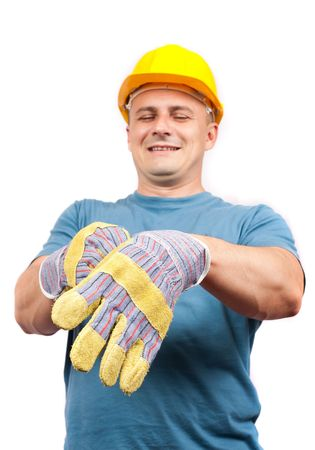 Blue collar worker with yellow helmet putting on leather protection gloves