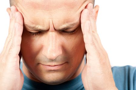 migraine: Young man with strong migraine, isolated on white background Stock Photo