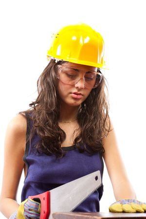 Beautiful woman as latino construction worker cutting with handsaw isolated on white background Stock Photo - 5725990