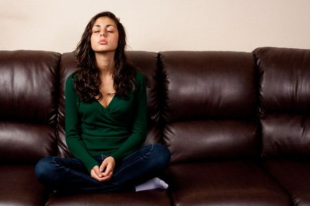 Portrait of a young lady sitting on a leather couch Stock Photo - 5725982