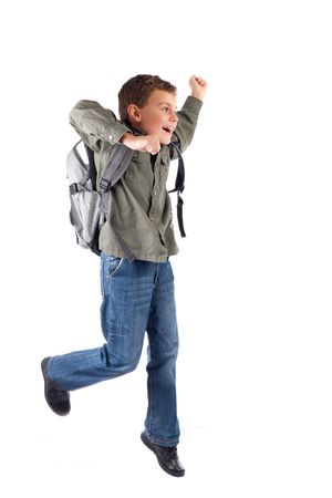 running late: Portrait of a cute schoolboy with backpack isolated on white background