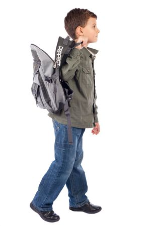 Retrato de un escolar con mochila cute aisladas sobre fondo blanco Foto de archivo