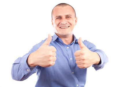 Portrait of a young happy businessman showing thumbs up sign, isolated on white background photo