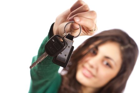 Young saleswoman handing over car keys, isolated on white background Stock Photo - 5828033
