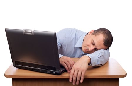 exhausted: Tired young businessman asleep at his desk isolated on white background Stock Photo