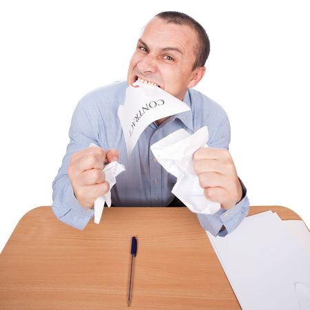 crazed: Mad businessman tearing apart a contract with his teeth, isolated on white background