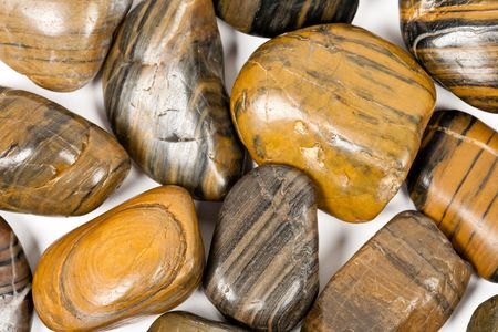 Close-up of shiny brown zen stones isolated on white background photo