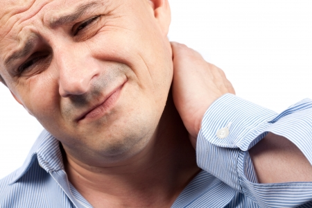 neck pain: Close up portrait of a young businessman with neck pain