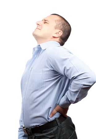 Young businessman with strong back pain, isolated on white background photo