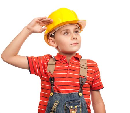 Cute kid putting on construction helmet, isolated on white background photo