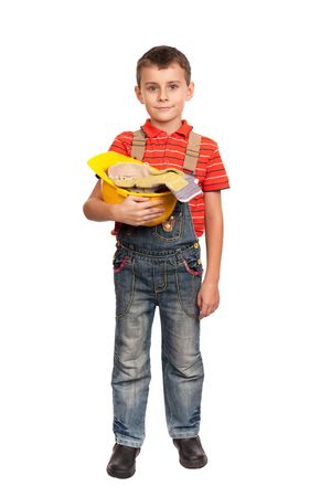 Portrait of a cute kid posing as a construction worker photo