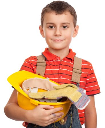 Close up portrait of a cute kid posing as a construction worker photo
