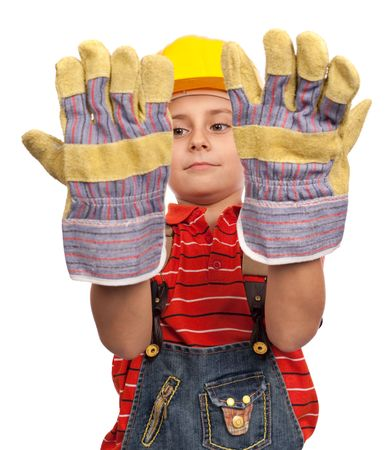 Portrait of a cute kid with protective gloves and hard hat photo