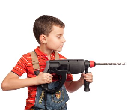Cute kid as a construction worker with drilling machine photo