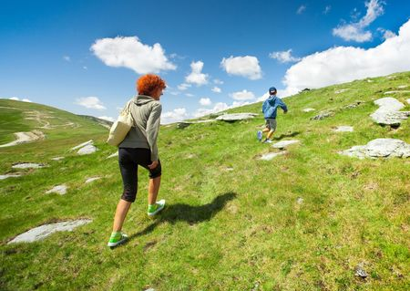 Mother and son hiking in mountains photo