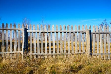 enclosures: Autumnal landscape with fence in a sunny day
