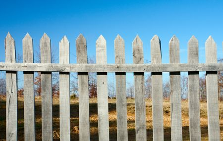 Autumnal landscape with fence in a sunny day photo