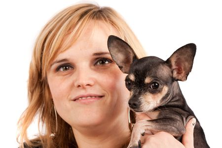 Close up portrait of a young blonde lady with her chihuahua photo