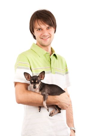 Funny portrait of a young man holding a cute chihuahua dog photo