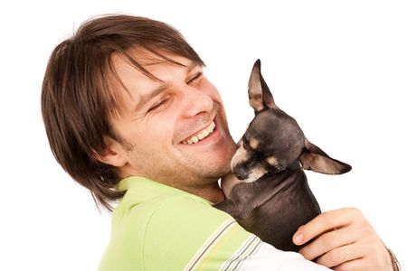 chihuahua dog: Funny portrait of a young man holding a cute chihuahua dog Stock Photo