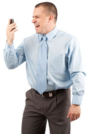 Portrait of a young businessman yelling on phone, isolated on white background photo
