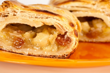 Studio close up of delicious apfelstrudel (apple pie) isolated on white background Stock Photo
