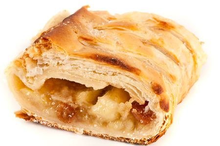 Studio close up of delicious apfelstrudel (apple pie) isolated on white background photo
