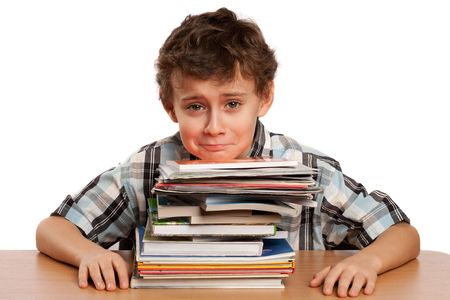 dreadful: Portrait of a schoolboy overwhelmed by the stack of books on his desk