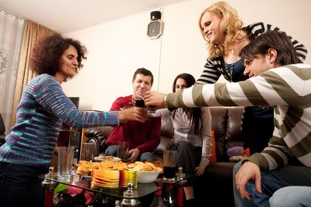 friends and family: Party people having some drinks together, celebrating, having fun