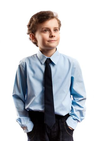 Portrait of a schoolboy isolated on white photo