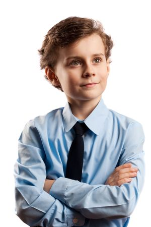 Portrait of a schoolboy isolated on white with his arms crossed photo
