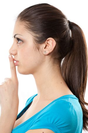 Closeup portrait of a young woman making silence sign photo
