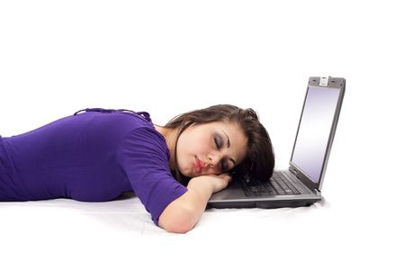 Portrait of a tired brunette sleeping on her laptop Stock Photo - 6475650