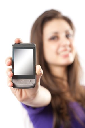 Young hispanic girl holding a mobile phone or PDA to the viewer