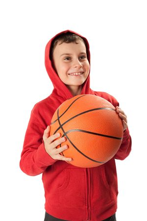 Portrait of a schoolboy with a basketball isolated on white