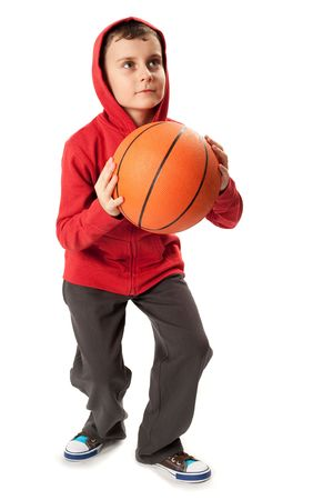 schoolboys: Portrait of a schoolboy with a basketball isolated on white