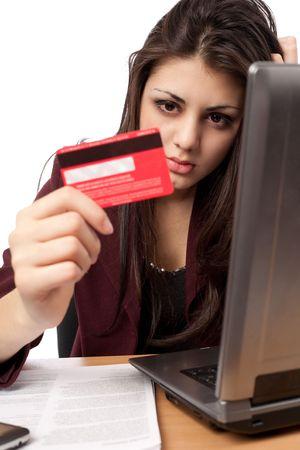 bank card: Young business lady with credit card and laptop