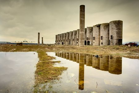 Abandoned facility under moody cloudy dark sky, image of decrepitude photo