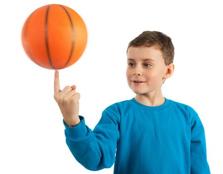 rotation: Cute kid spinning basketball on index finger, some motion blur on ball